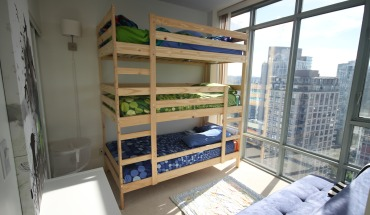 The finished product is a triple bunk that let's all three boys sleep in one bed! - See more at: http://5kids1condo.com/hacking-your-way-to-kid-stacking/#sthash.Ai4roERV.dpuf