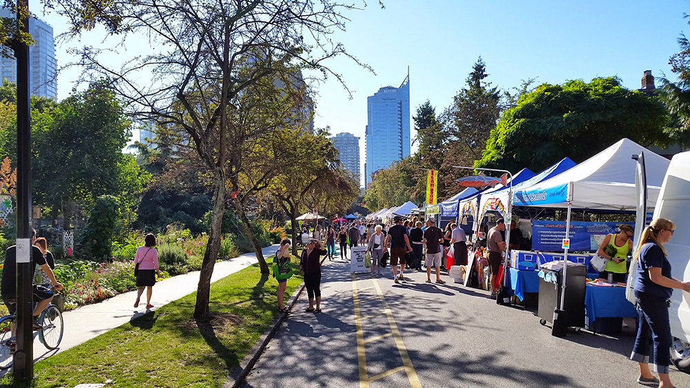 A summer farmer's market in the center of downtown Vancouver.
