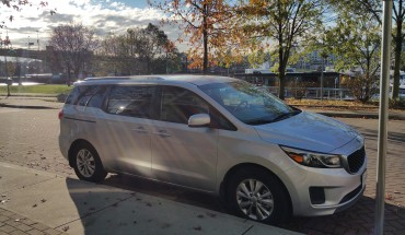 This is a 2015 Kia minivan, part of the Modo carshare. It costs just $8/hour to rent!