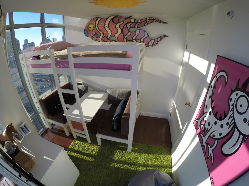 The lower bunk on the girls' bed converts to a table and bench combo during the day.