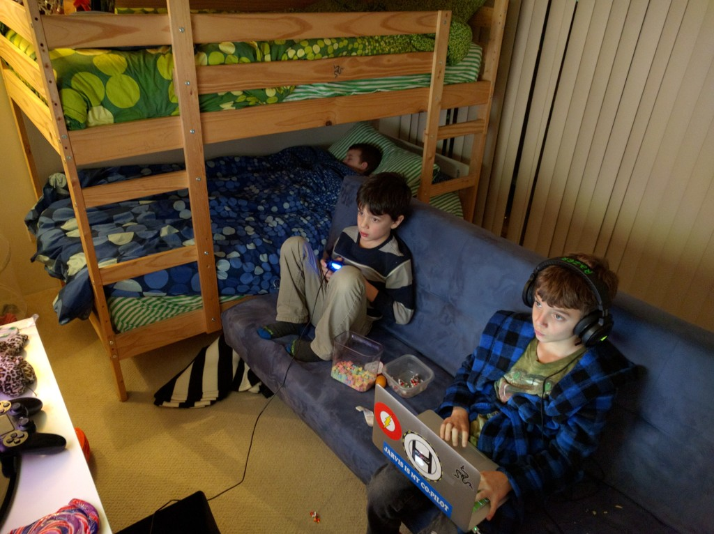 The boys turn the couch toward the TV to make their room into a gaming lounge.