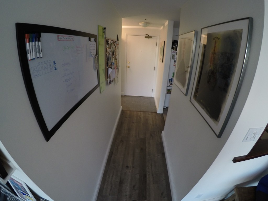 The green glass dry erase board on the left (between the whiteboard and corkboard) is in the hallway - a high viz area to put weekly plans in.