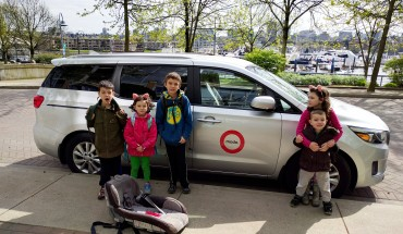 The kids in front of the Modo minivan we book every couple weeks or so. Just $8 an hour!