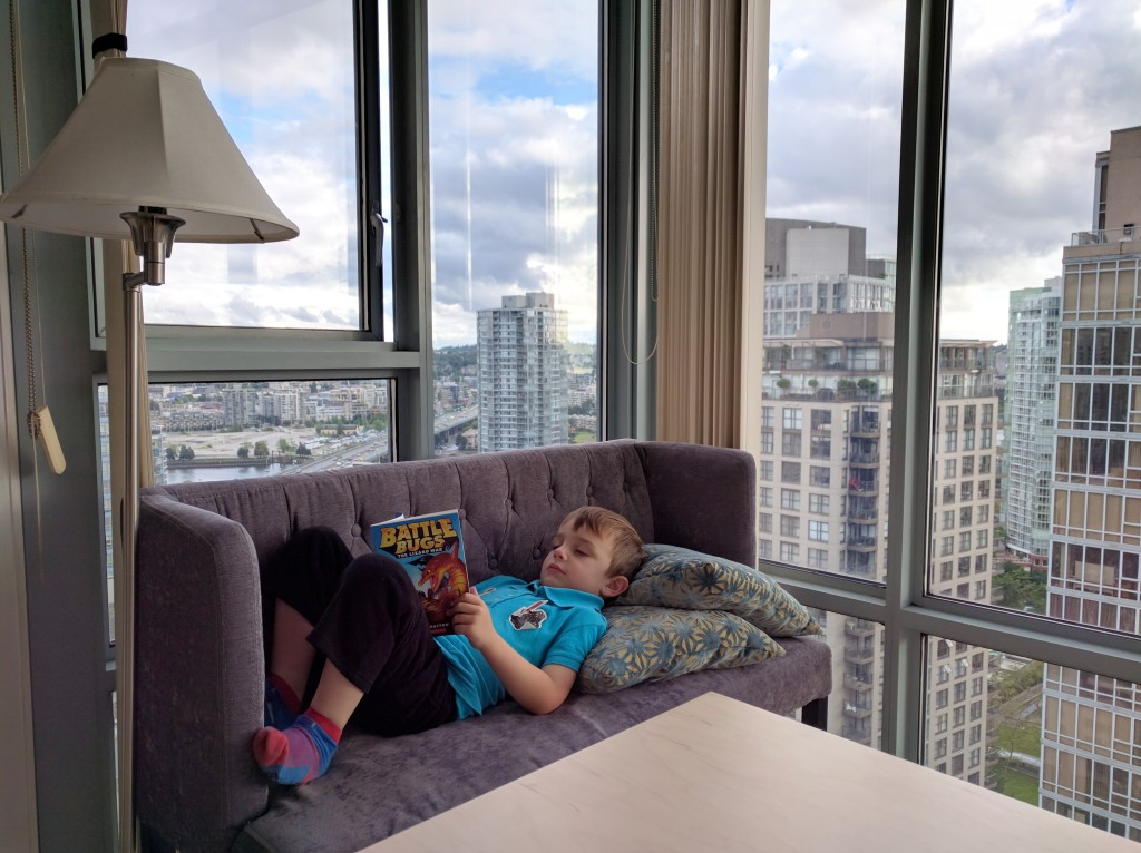 The youngest, finding some quiet space on my settee to check out a book during the day.