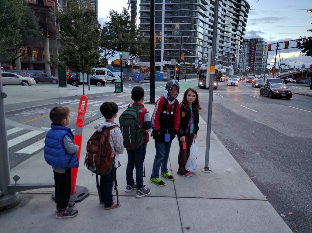 The kids queued up to get on the bus in the morning.